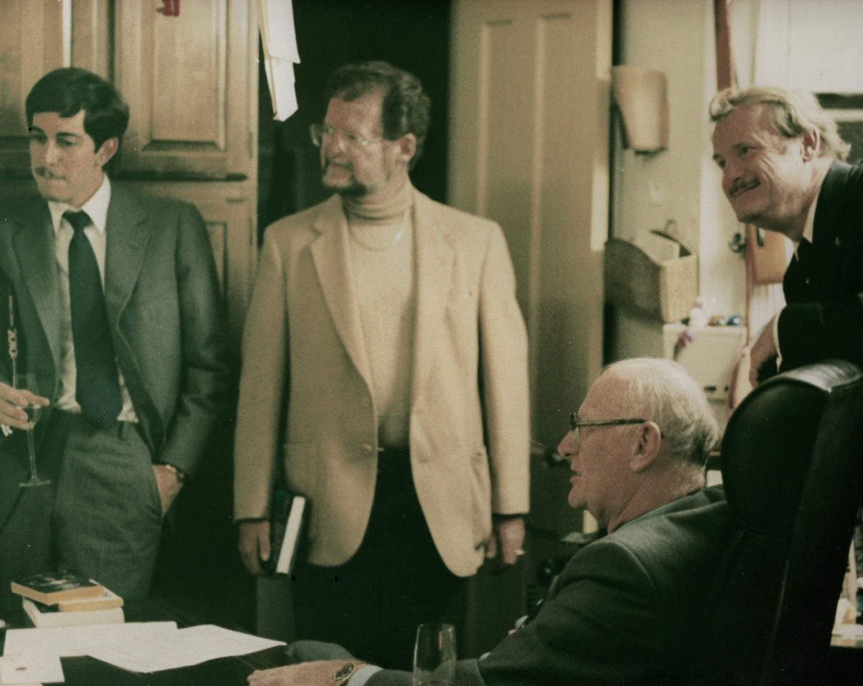 Left to right, Gary C Hudson, Larry Niven, Jerry Pournelle (standing) Seated: Arthur C. Clarke.  At the 1983 Citizen's Council meeting.  Credit: J. Ransom.